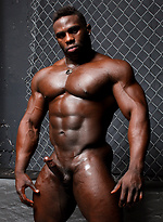Ebony bodybuilder Aden Taylor stokes his muscled cock