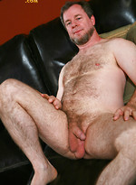 Chubby hairy man David Mushulom strokes dick