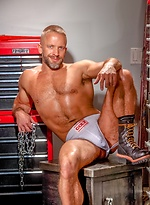 Hot muscle man Dirk Caber posing