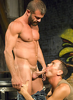 Muscled men fist his younger buddy\'s ass